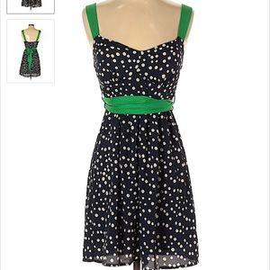 Polka dot dress with green sash